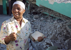 Noel Zierne shows where she was trapped in the rubble of the church following the earthquake.