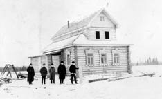 Workers stand in front of the Methodist chapel and parsonage in Haitolovo,  Russia. A UMNS photo courtesy of  the United Methodist Commission  on Archives and History.