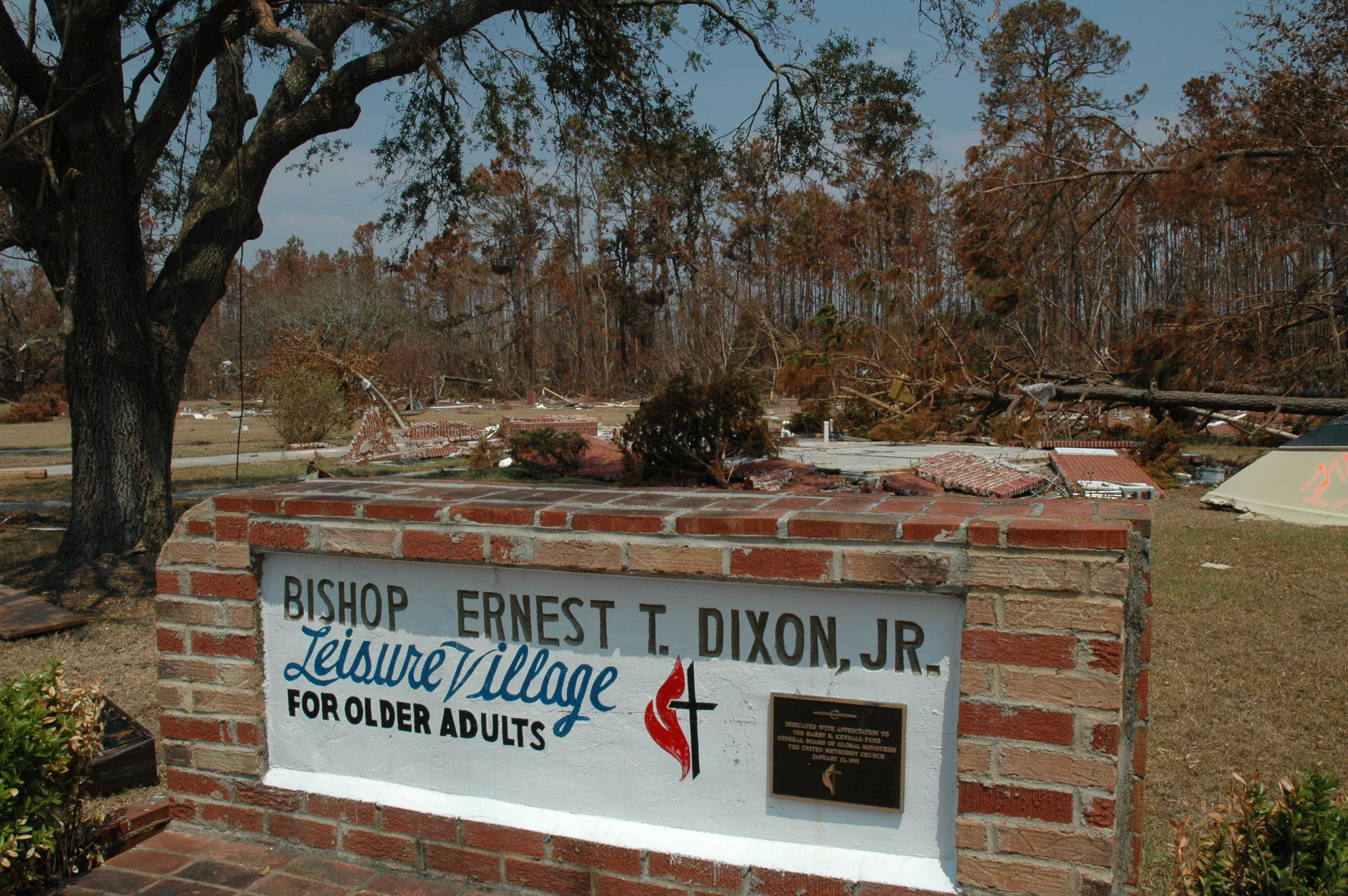 While the cottages that made up Gulfside's Ernest T. Dixon Leisure Village for Older Adults no longer exist, the sign remains unharmed. A UMNS photo by the Rev. Larry Hollon.