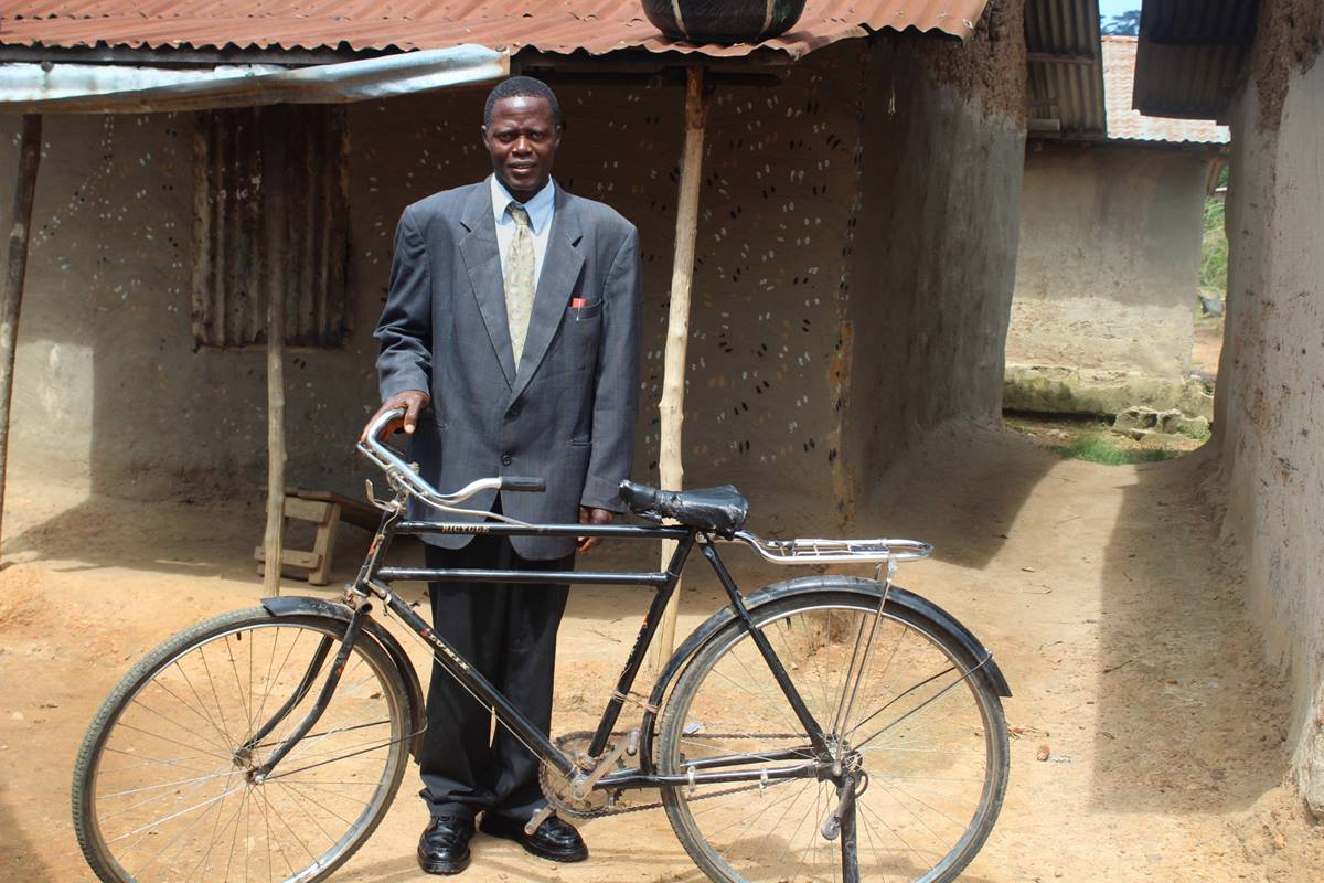 Pastor James Yarkpawolo said his pastoral ministry at Telemu United Methodist Church in Liberia has greatly improved since he received a bicycle as part of The United Methodist Church's Bikes and Bibles ministry. Photo be E Julu Swen, UMNS.