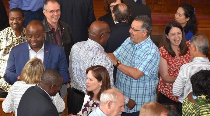 "Members of the Commission on a Way Forward converse with each other as they complete their final commission meeting on May 23 at the Upper Room chapel in Nashville, Tenn. Many commission members credit the book ""The Anatomy of Peace"" with helping them work together. Photo by Maidstone Mulenga, Council of Bishops."