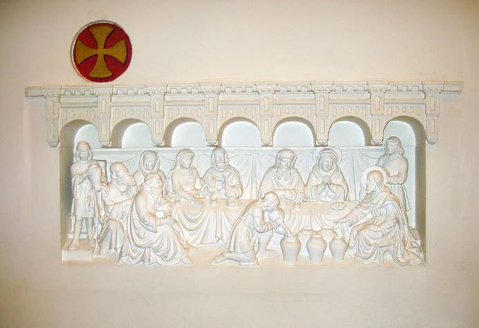 A panel on the back wall inside of Joannes de Dooper Church in Pijnacker, Netherlands, depicts the wedding feast at Cana. Photo by Hpruxpbvm, courtesy of Wikimedia Commons.