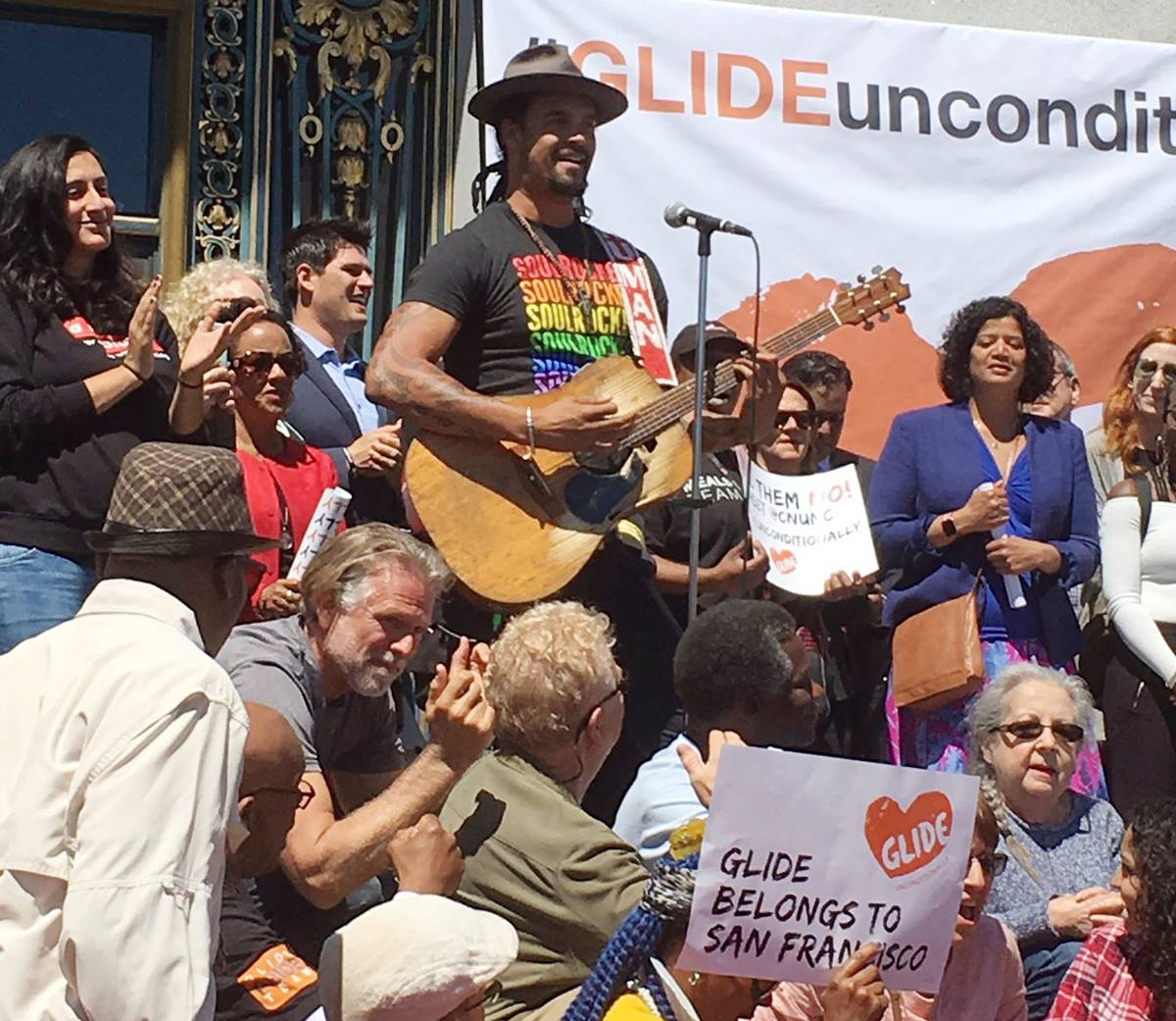 Singer Michael Franti joins the rally for Glide Memorial United Methodist Church in front of San Francisco's City Hall on June 21. Photo by Beth Frankland