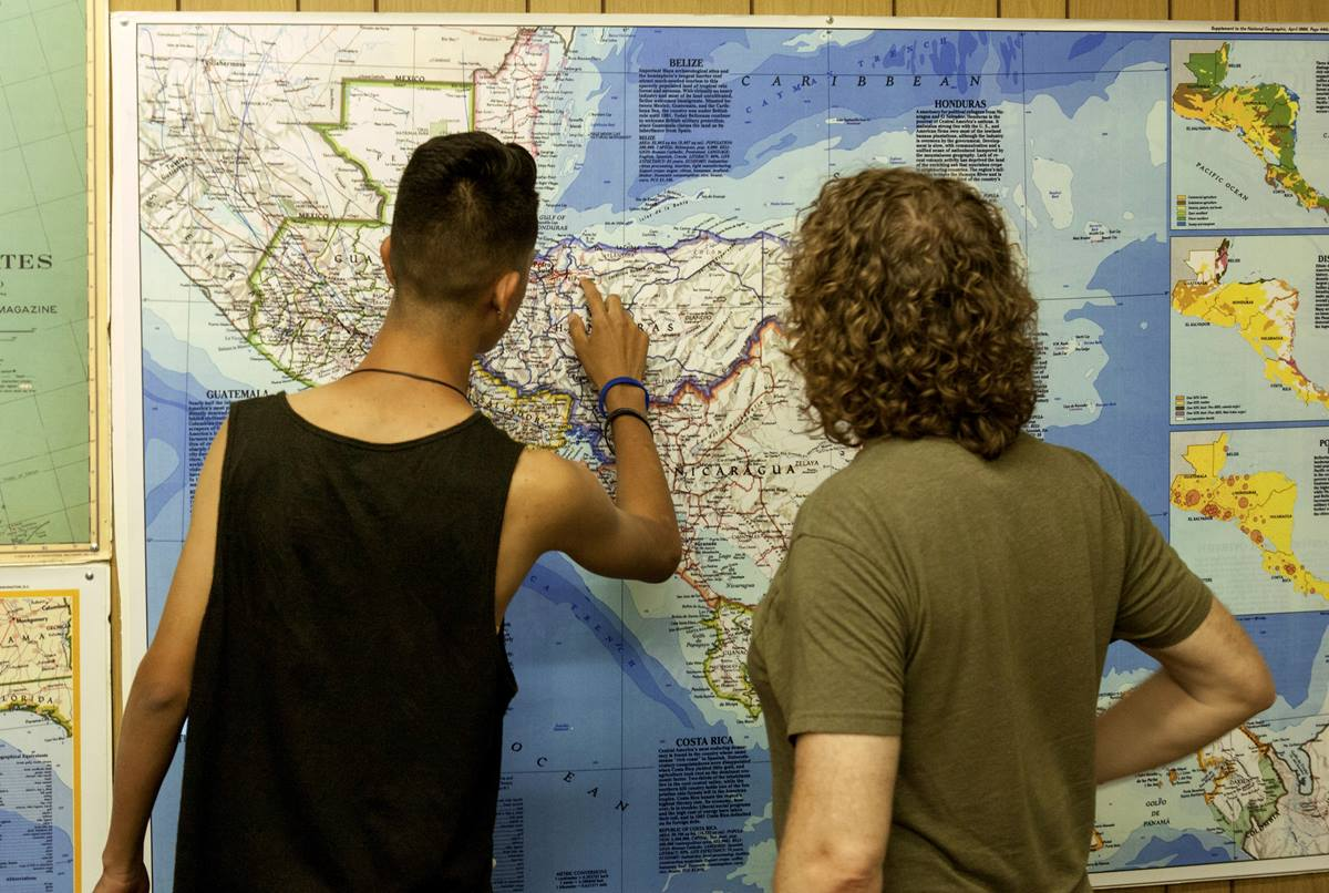 Unaccompanied minor migrants enjoy four days at a United Methodist summer camp. They point out their home towns and trace the journey they took to arrive at U.S. border on a large wall map. Photo courtesy of California-Pacific Conference.