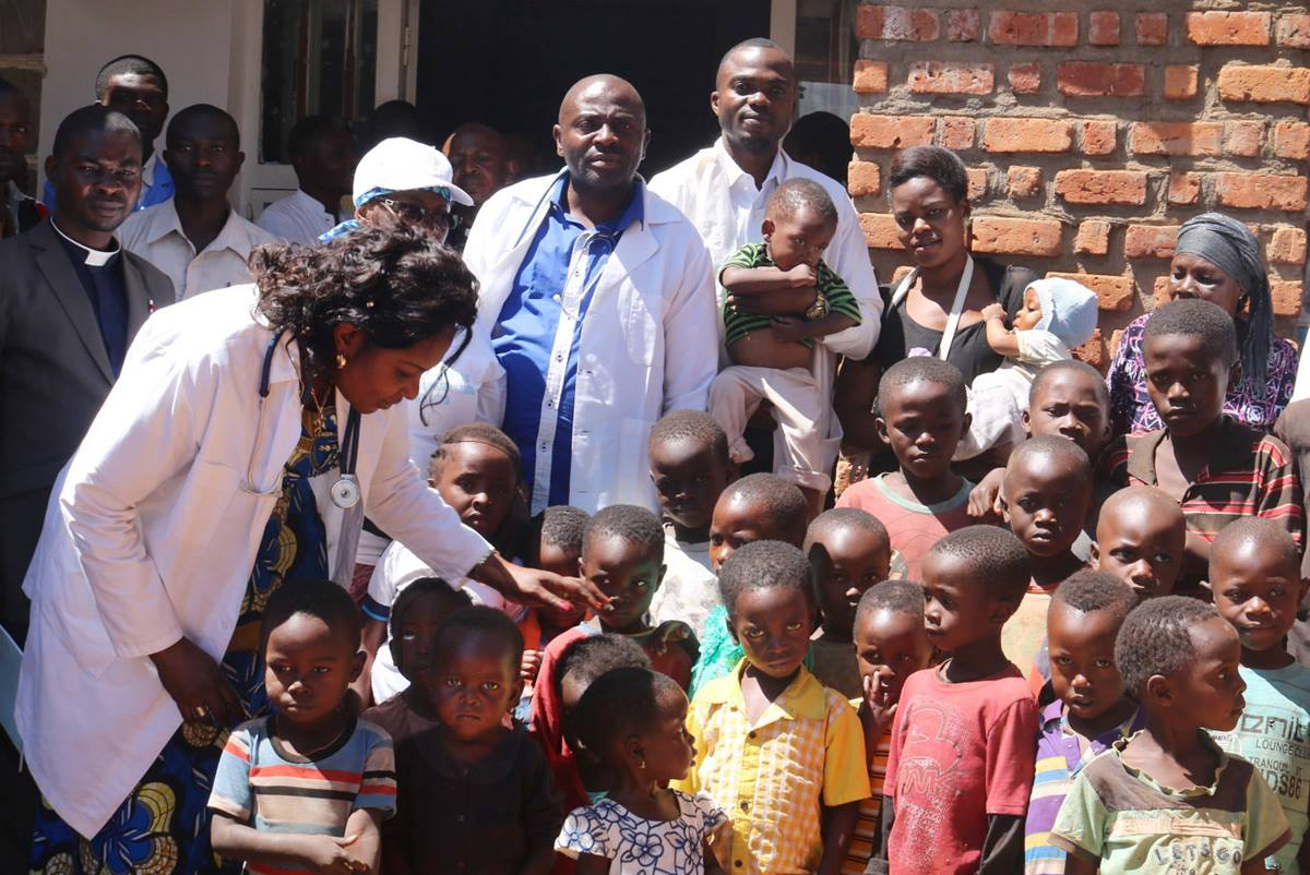Dr. Marie Claire Manafundu (left) visits children in the Irambo neighborhood in Bukavu, Democratic Republic of Congo, where poor nutrition has become a problem, especially for children. Photo by Philippe Kituka Lolonga, UMNS.