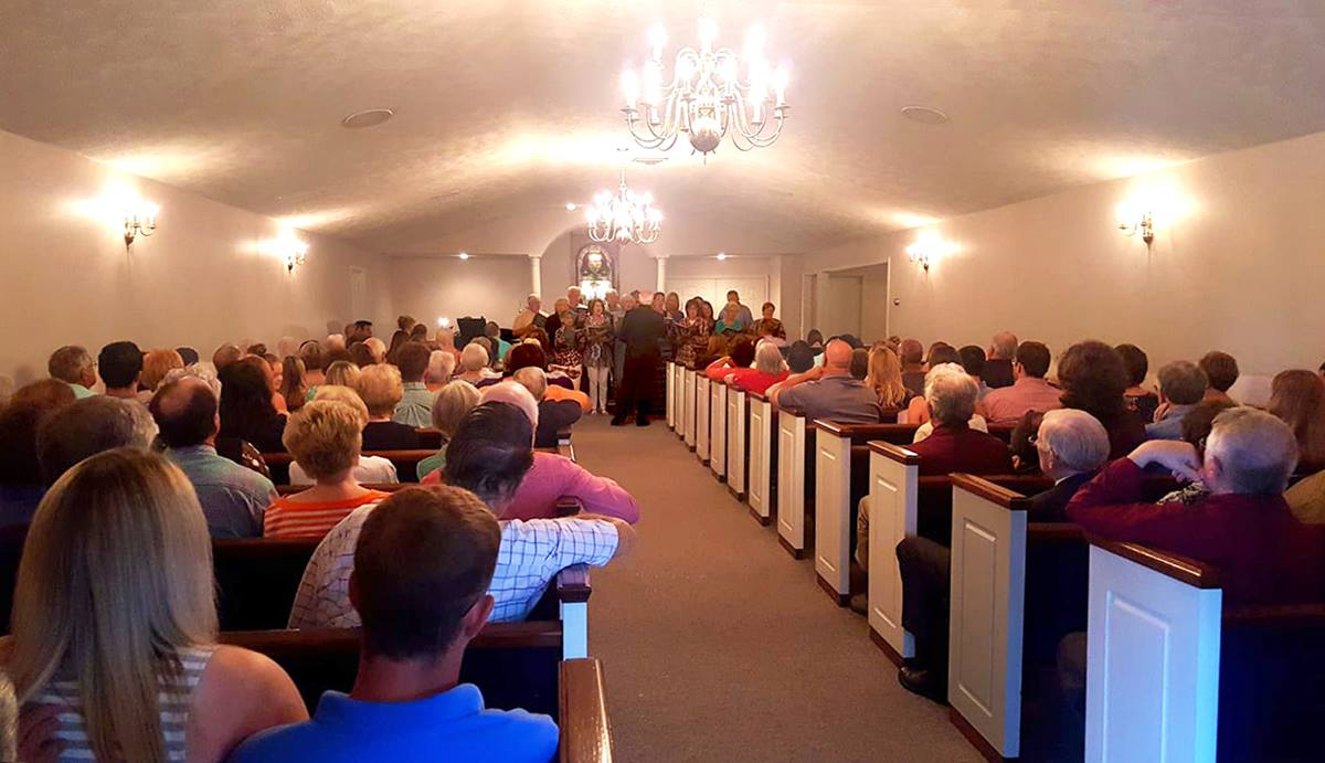 Worshippers, many of whom voted to withdraw from The United Methodist Church, join in a service May 27 at the Porter Funeral Home Chapel in Louisville, Miss. The Mississippi Conference is seeking to keep First United Methodist Church property in United Methodist hands. Photo courtesy of the Rev. Mike Childs.