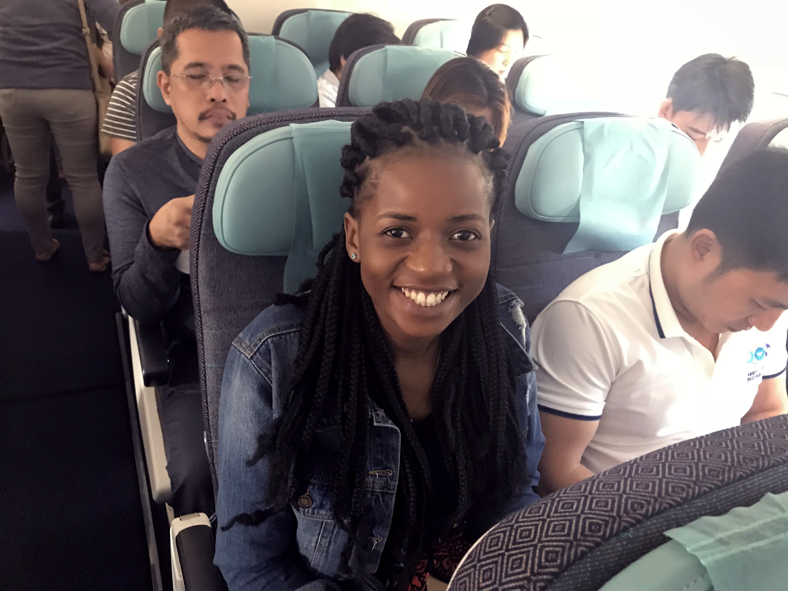 Miracle Osman smiles as she waits for her flight to depart from Davao to Manila. Osman is working with Filipino attorneys on paperwork to allow her to leave the Philippines. Photo courtesy of Thomas Kemper, GBGM.