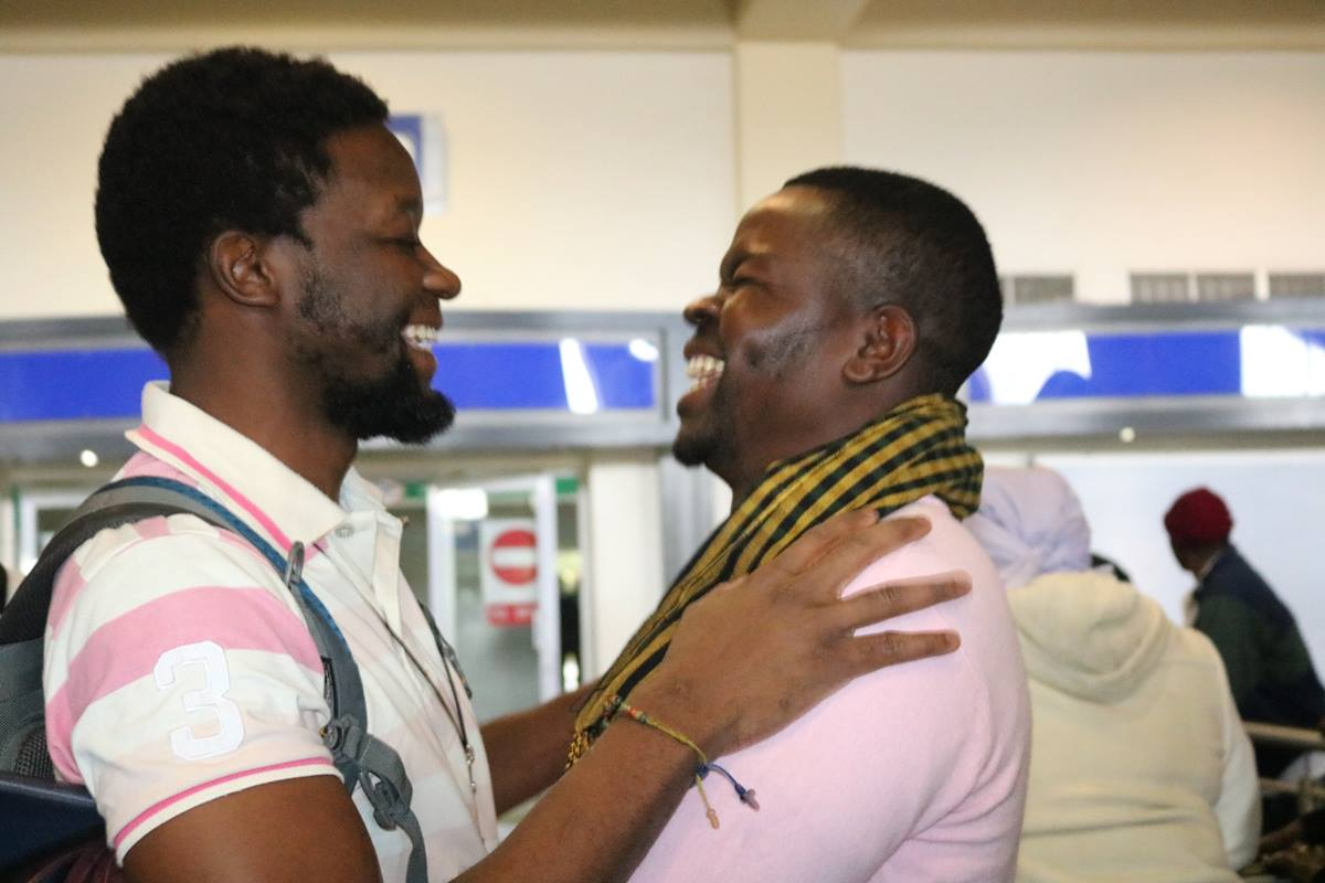 Tawanda Chandiwana is greeted by Russell Rusike, a fellow Zimbabwean Global Mission Fellow, at the airport in Harare, Zimbabwe. Chandiwana arrived home from the Philippines, where he had been detained since May 9. Photo by Taurai Emmanuel Maforo, UMNS.