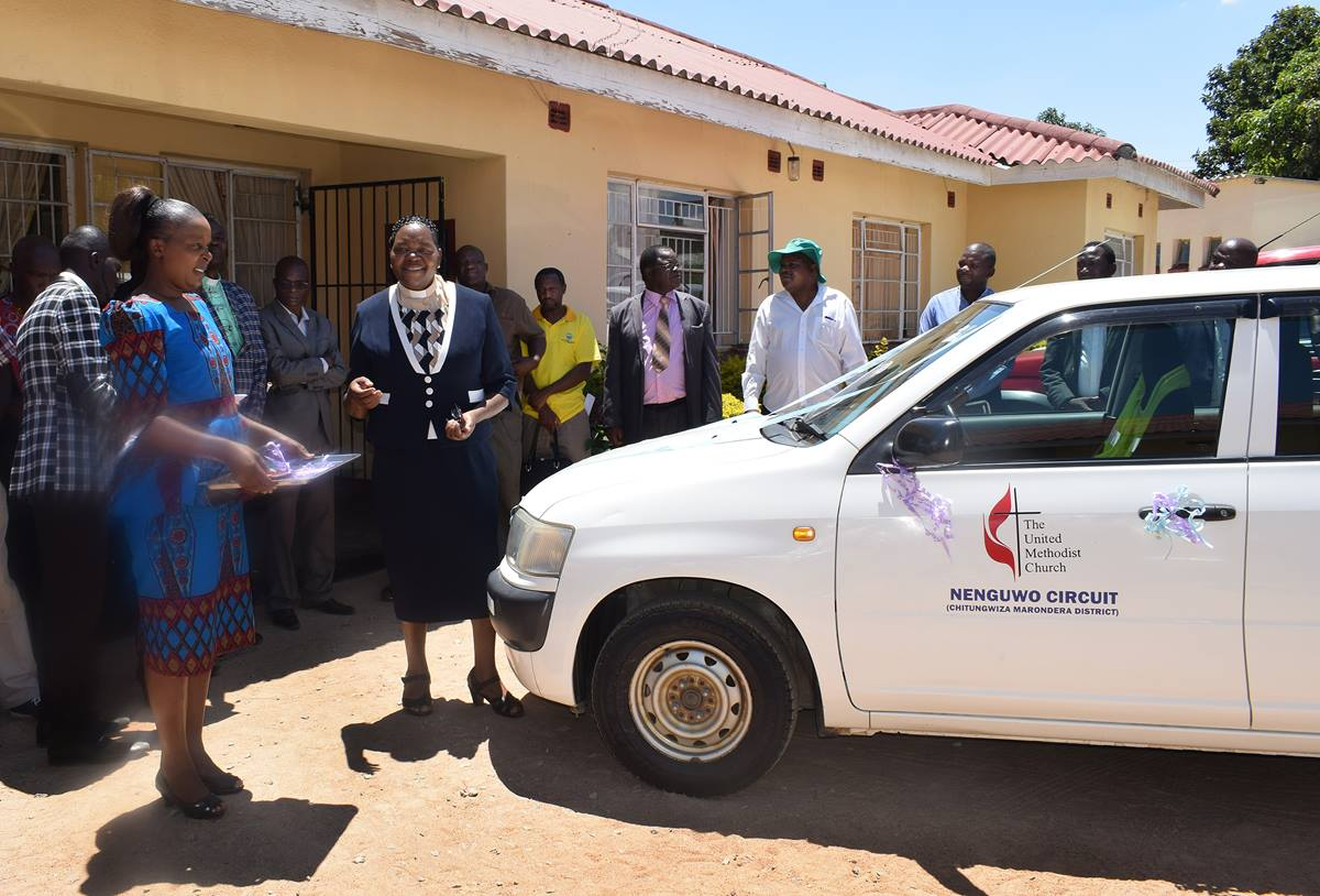 Church members and leaders celebrate the purchase of a car for use by United Methodist pastors in the Nenguwo Circuit outside Harare, Zimbabwe. Photo by Eveline Chikwanah.
