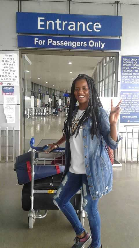 United Methodist missionary Miracle Osman prepares to depart Ninoy Aquino International Airport in Manila, Philippines. Osman has returned to her home in Malawi. Photo by Marie Villalon.