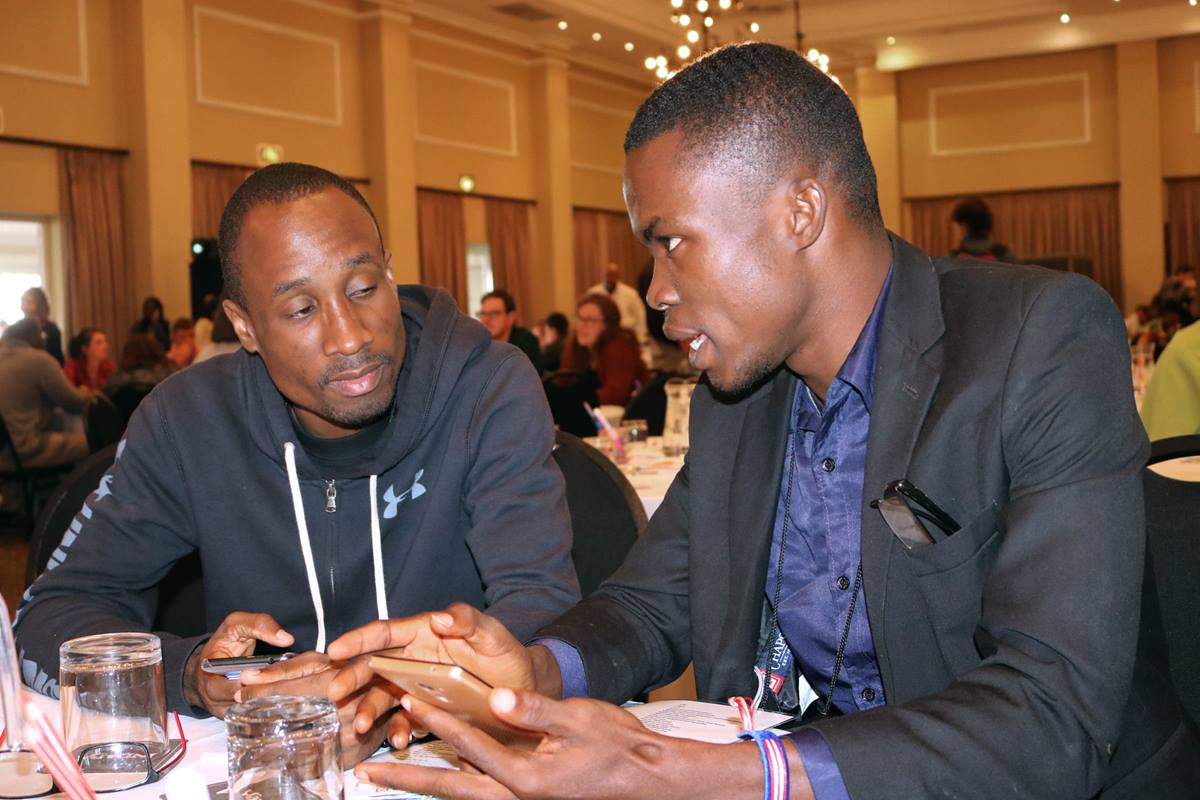 Landry Seki of Côte D'Ivoire (left) and Bill N. Gaye of Liberia visit at the United Methodist Global Young People's Convocation in Johannesburg, South Africa. Photo by Eveline Chikwanah.