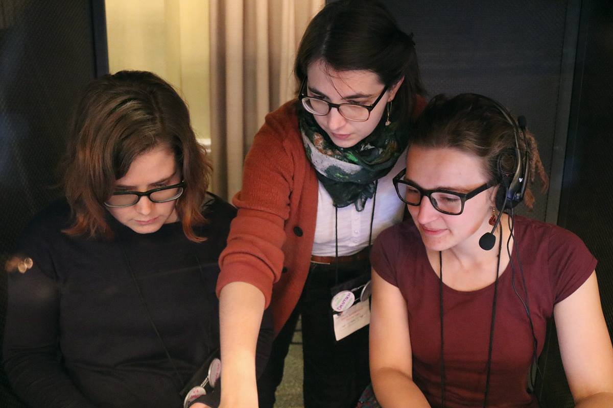 Translators (from left) Katherine Jolly, Maria Sonnleithner and Deborah Detka work together in the German translation booth at the Global Young People's Convocation in Johannesburg, South Africa. Photo by Eveline Chikwanah, UMNS.