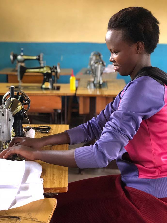Rose Uwanmugira, a young adult in the Rwanda Provisional Conference, is studying tailoring with a grant from the Center for Health and Hope. Funds were raised by Rev. Tom Owens, a United Methodist pastor in Asheville, N.C., a year ago when he and friends ran a marathon up the 14,000-foot Pikes Peak in Colorado Springs, Colo. Photo by Donald E. Messer.