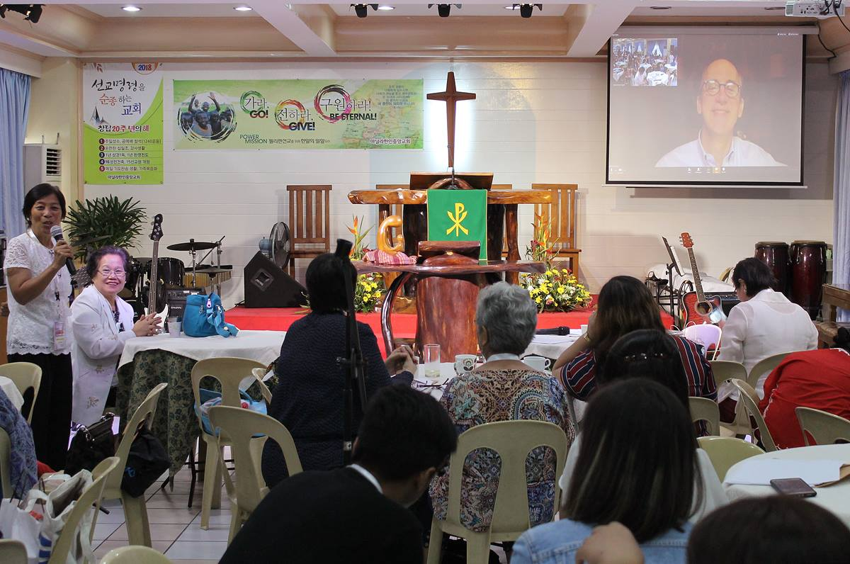 Dave Nuckols, a member of the Commission on a Way Forward, addresses a forum by video call. The discussion organized by the Board of Women's Work was held July 24 in Manila, Philippines. Photo by Gladys Mangiduyos, UMNS.