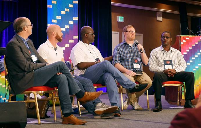 The Rev. Brian Atkins (second from right) speaks about the plans on offer from the Commission on Way Forward during the For Everyone Born gathering in St. Louis. Fellow commission members (from left) Dave Nuckols, Matt Berryman and Scott Johnson (furthest right) spoke about their work. Randall Miller (center) moderated the conversation. Photo by Heather Hahn, UMNS