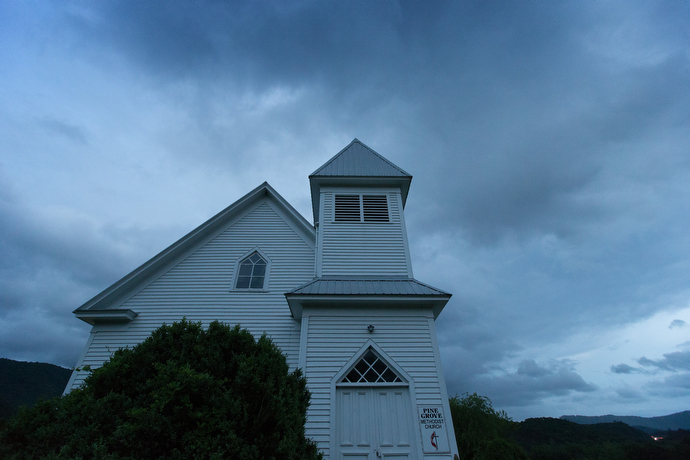 Storm clouds swirl behind Pine Grove United Methodist Church in Bastian, Va., one of two churches pastored by the Rev. Alan Ashworth that have outreach ministries with the Appalachian Trail community. Photo by MIke DuBose, UMNS.