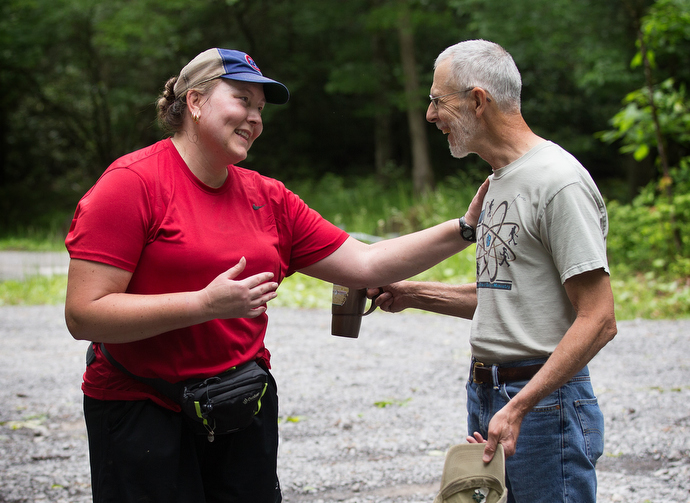 """The Rev. Alan Ashworth (right) shares a laugh with Appalachian Trail thru-hiker """"Flame"""" at a free hiker feed sponsored by New Hope Union United Methodist Church near Bastian, Va. Photo by Mike DuBose, UMNS."""