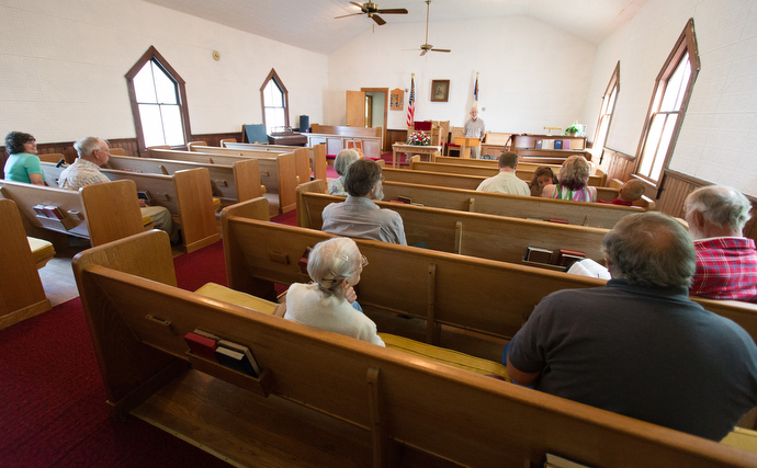 The Rev. Alan Ashworth (rear) gives the sermon during worship at New Hope Union United Methodist Church in Bastian, Va. The small congregation is active in ministry with hikers along the nearby Appalachian Trail. Photo by MIke DuBose, UMNS.