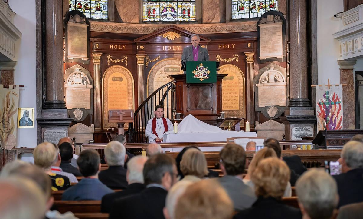 United Methodist Bishop Bruce Ough preaches from the pulpit at historic Wesley's Chapel in London during the opening worship service of a 50th anniversary celebration of the concordat agreement between the United Methodist and British Methodist churches. Photo by Alex Baker.
