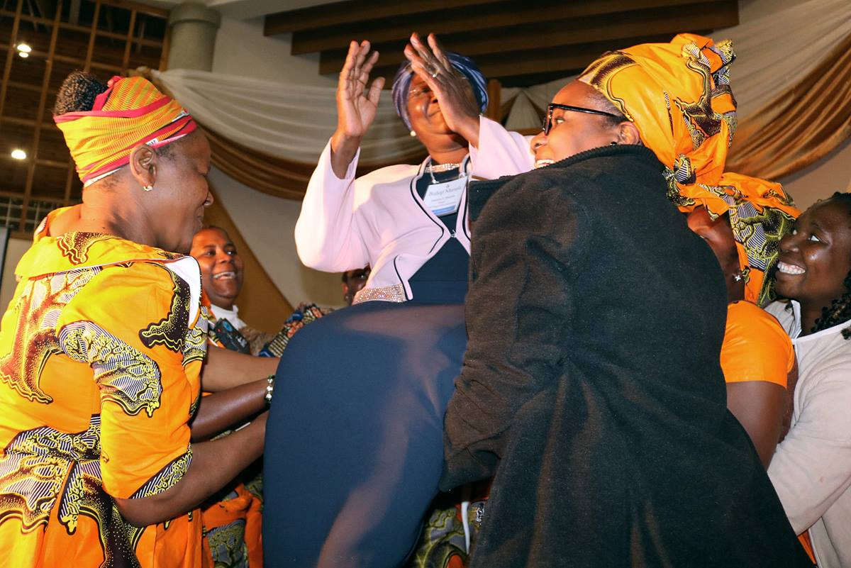 Clergywomen from Mozambique lift Bishop Joaquina F. Nhanala in her chair during a celebration of her service to The United Methodist Church at Africa University. Photo by Eveline Chikwanah, UMNS.