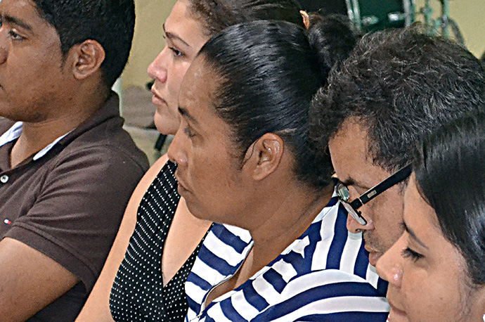 Miriam Valerio (center) tells what happened to her family when her husband left Honduras to seek work in the United States during a workshop about migration sponsored by the National Plan for Hispanic-Latino Ministry, at United Methodist Central Church in Danli, Honduras. Photo by Carlos Reyes, UMNS-NPHLM.