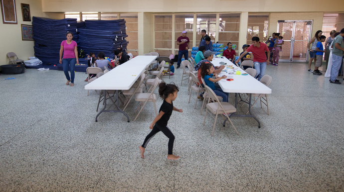 A young girl scampers across the cool terrazzo floor while families rest and relax at an overflow shelter for recent immigrants at the Basilica of Our Lady of San Juan del Valle. Photo by Mike DuBose, UMNS.