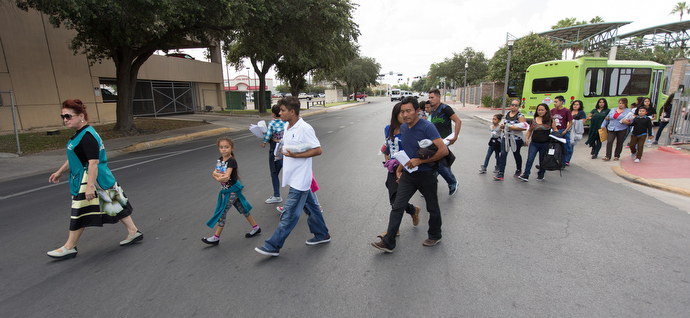 Blanca Muñoz (left) leads immigrants from the bus station to the Catholic Charities Humanitarian Respite Center in McAllen, Texas. Photo by Mike DuBose, UMNS.