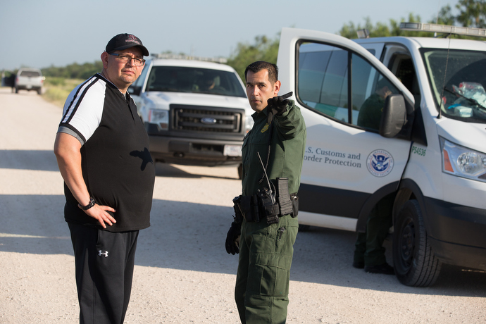 The Rev. Robert Lopez (left) learns firsthand about the work of the U.S. Border Patrol from agent Robert Rodriguez along the Rio Grande near McAllen. Lopez is superintendent of The United Methodist Church's El Valle and Coastal Bend Districts in the Rio Texas Conference. Photo by Mike DuBose, UMNS.