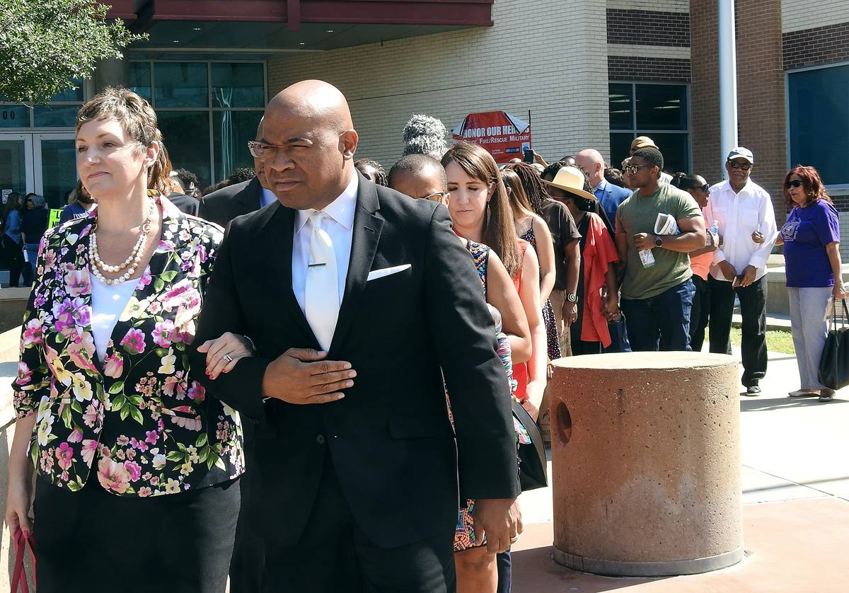 The Rev. Abril Goforth (left) and the Rev. Edlen Cowley lead a march of United Methodists from Dallas police headquarters to the apartment complex where a white officer shot and killed a black man in his residence. The group called for justice for 26-year-old victim Botham Jean. Photo by Sam Hodges, UMNS.