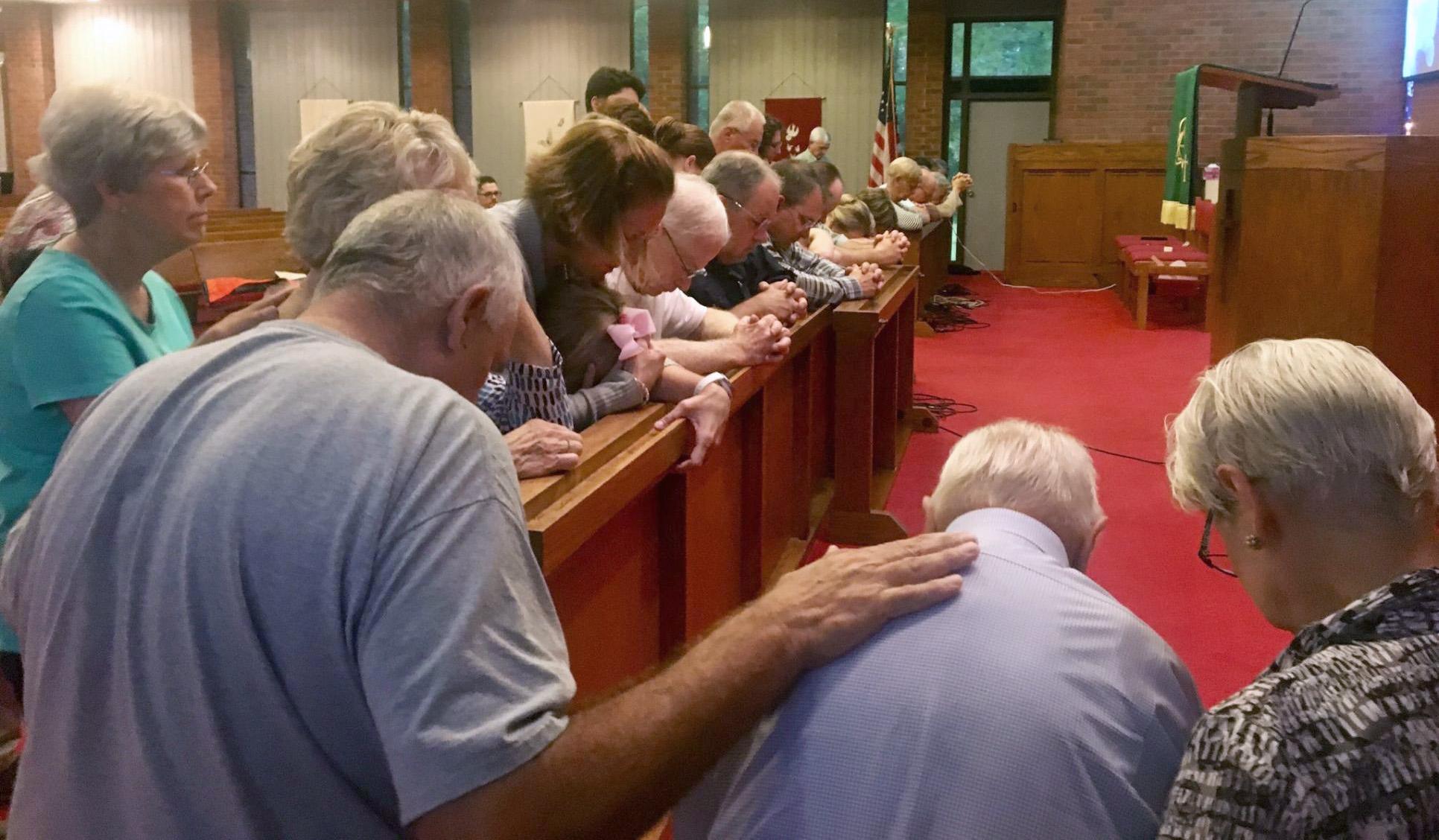 Parishioners pray for Jadon Olsen at Saint Luke United Methodist Church in Laurinburg, N.C. Photo courtesy of the Rev. William A. Olsen.