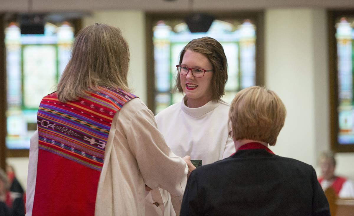 The Rev. Nicole Anderson is congratulated after being commissioned as a Dakotas Conference provisional elder. Anderson, 28, now serves as pastor of First United Methodist Church in Vermillion, South Dakota. The latest Lewis Center for Church Leadership study on clergy age trends in the denomination shows a three-year decline in young women elders. Photo courtesy of the Dakotas Conference.