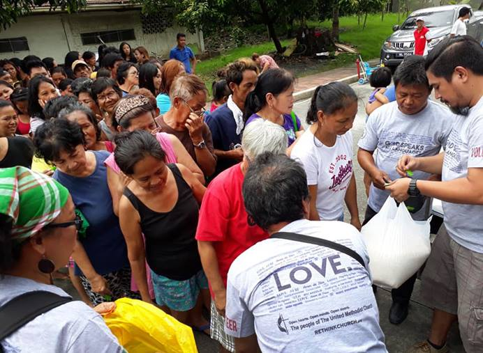 A United Methodist team led by Liza Cortez assisted the victims of August monsoon flooding in Marikina City, Philippines.  Each family was given a pail holding 10 kilos of rice, dried fish, mongo, cooking oil, sardines and a pack of biscuits. Photo courtesy of Liza Cortez.