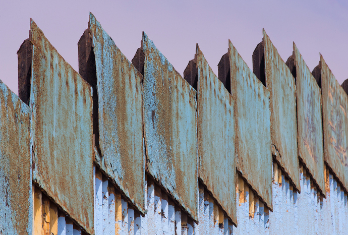 Steel plates stand atop the posts of the border fence that marks the boundary between Mexico and the U.S. at El Faro Park in Tijuana. Photo by Mike DuBose, UMNS.