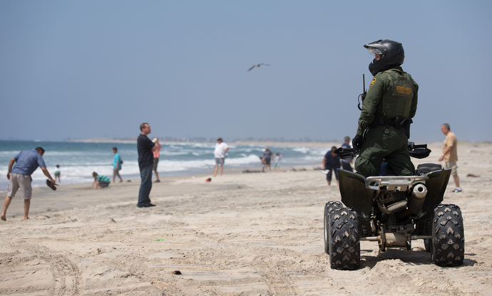A U.S. Border Patrol agent keeps watch over beach goers along the border between the U.S. and Mexico just outside Friendship Park near San Diego. Photo by Mike DuBose, UMNS.