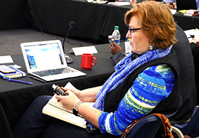 The Rev. Juliet Spencer, a commission member from the Louisiana Conference, tests out a new voting device that will be used by General Conference delegates in 2019 and 2020. Photo by Heather Hahn, UMNS.