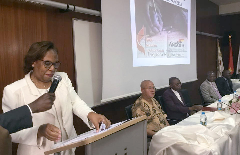 """Maria Cândida Teixeira (left), the Angolan minister of education, says """"more than four million Angolans between the ages of 15 and 35 still do not know how to read or write."""" She spoke in Luanda during the signing of an agreement between the ministry of education and The United Methodist Church in Angola to improve literacy. Photo by Orlando da Cruz, UMNS."""