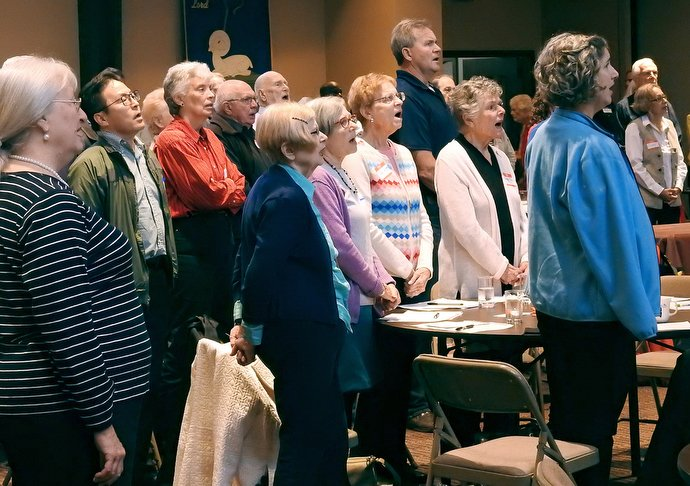 A Minnesota Conference meeting about the Commission on a Way Forward report included time for hymn singing. Bishop Bruce R. Ough led the session at Normandale Hylands United Methodist Church, one of 15 he scheduled for the Minnesota and Dakotas conferences. Photo by Sam Hodges UMNS.