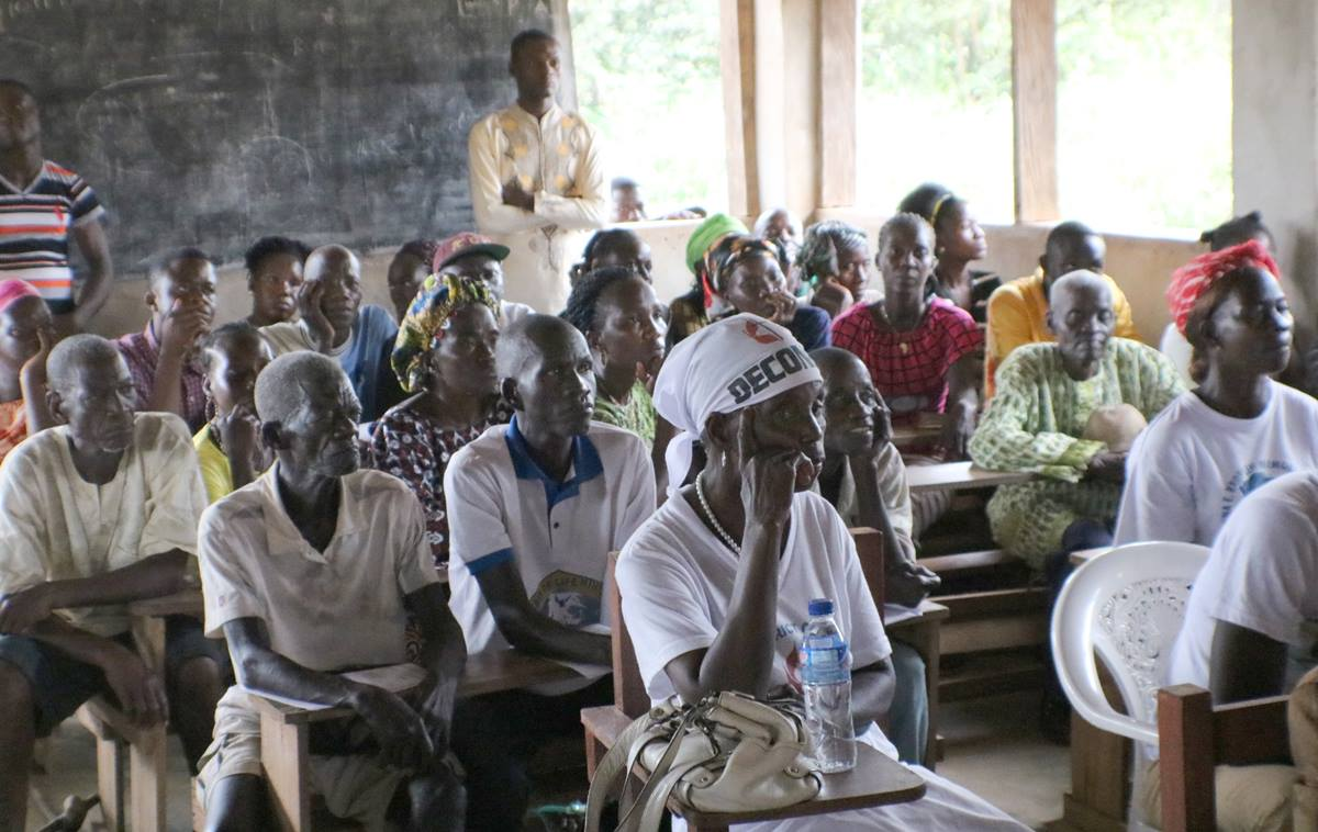 Parents attend a dedication ceremony for a new public school in the Tonglaywein Community in Nimba County, Liberia. Photo by E Julu Swen, UMNS.