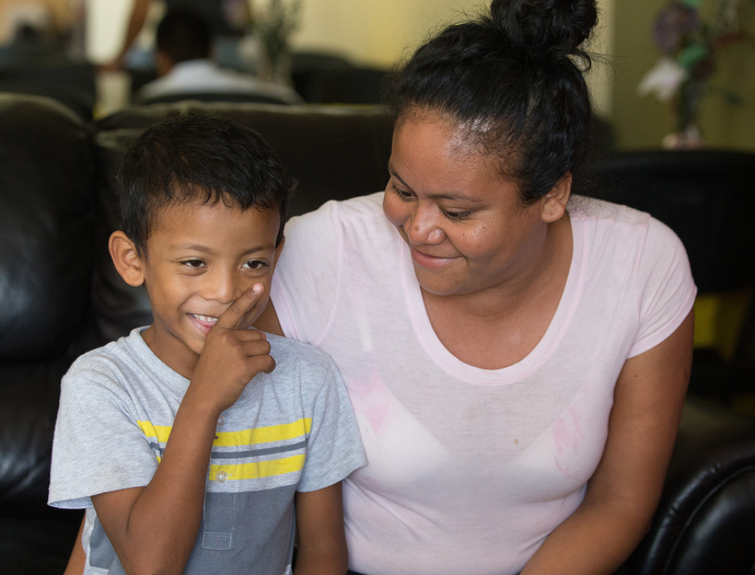 """Jose Carlos Villegas and his mother, Jamie Silva Marcella, are staying at the """"Door of Hope"""" Salvation Army shelter in Tijuana, Mexico. They were fleeing violence in their home state of Guerrero, Mexico. Photo by Mike DuBose, UMNS."""