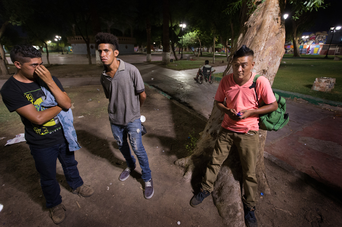 Migrants who have recently arrived from Honduras are among those who were offered a meal and prayer service by the Methodist Church of Mexico at Mariachi Plaza in Mexicali. Photo by Mike DuBose, UMNS.