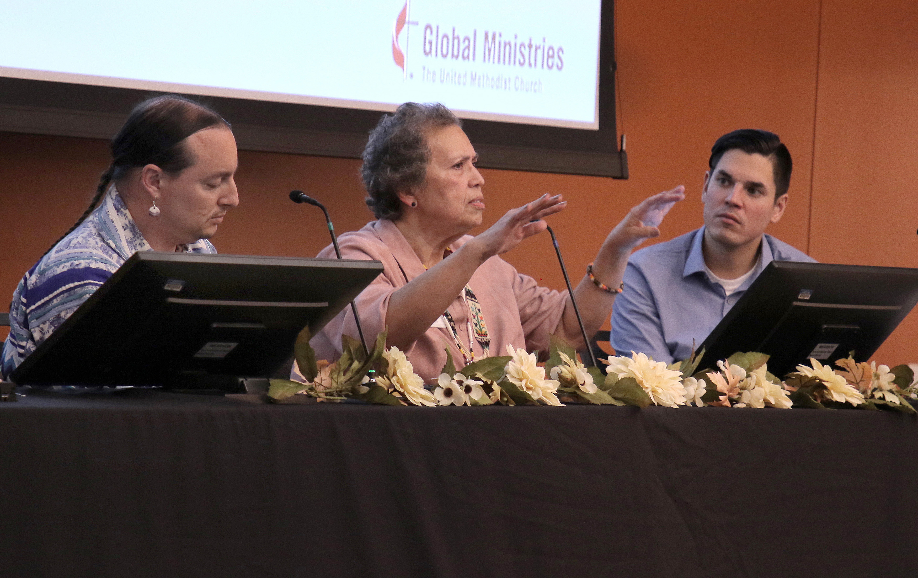 """Marcus Briggs-Cloud, the Rev. Anita Phillips and filmmaker John Little lead a panel discussion after the screening of """"More Than a Word"""" during the fall meeting of the Board of Global Ministries. Photo by Anthony Trueheart, Global Ministries."""