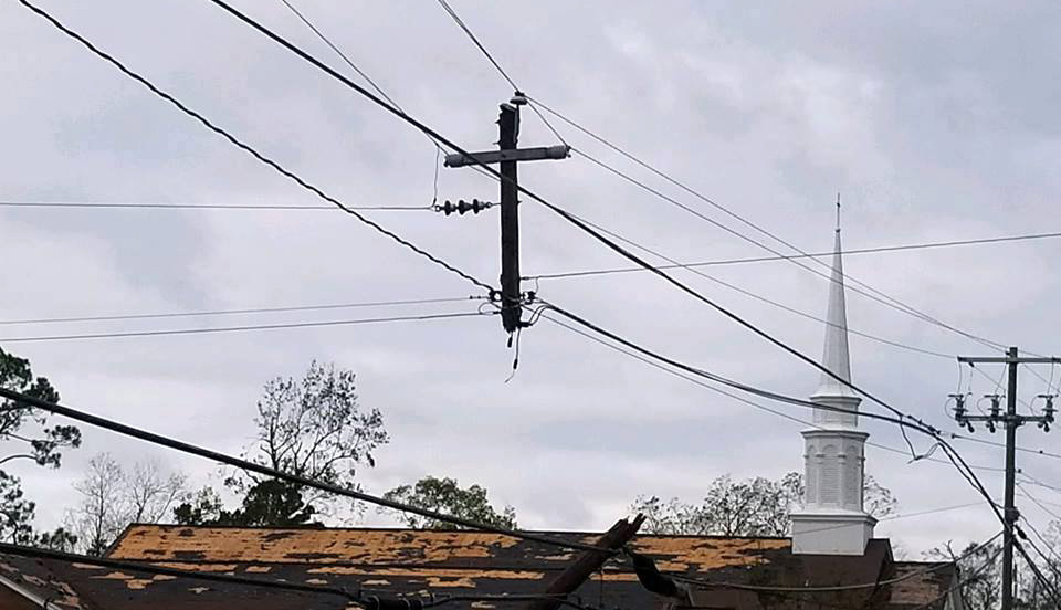 A utility pole destroyed by Hurricane Michael is left in the shape of a cross in front of Colquitt (Ga.) United Methodist Church. Photo courtesy of Colquitt United Methodist Church.