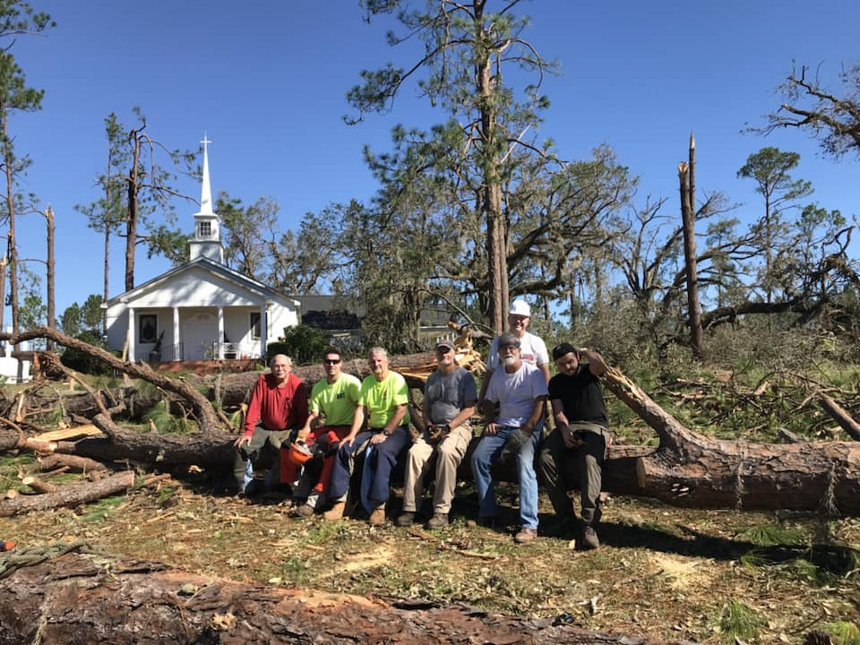 An early response team from Pierce Chapel United Methodist Church in Midland, Ga., pauses from their work in cleaning up storm debris left by Hurricane Michael at Cooks Union United Methodist Church in Colquitt, Ga. Photo courtesy of the South Georgia Conference.