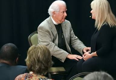 """In a skit for Do No Harm 2018, Paul Ballard plays """"Pastor John"""" and the Rev. Sally Bevill plays """"Sally,"""" two fictional characters whose counseling session crosses into romance. Ballard and Bevill joined others from the Mississippi Conference in staging the short drama, aimed at prompting discussion about sexual misconduct in the church. Do No Harm is The United Methodist Church's every-few-years sexual ethics summit, and this year's was held in San Antonio. Photo by Sam Hodges, UMNS."""