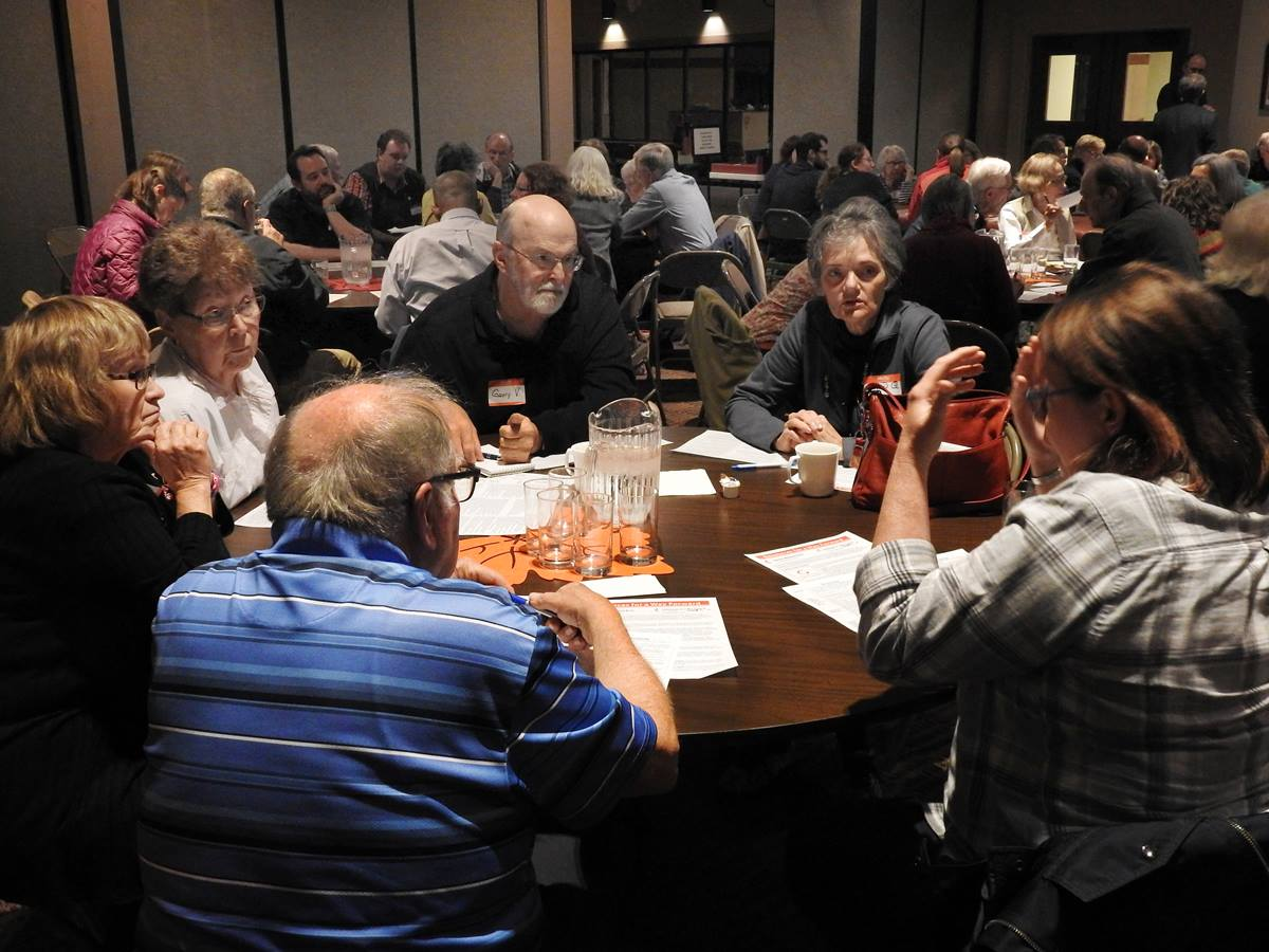 Minnesota Conference clergy and laity gathered at Normandale Hylands United Methodist Church hold table talk discussions about the three plans set to be considered by the special General Conference. Many United Methodist Conferences have been having town all meetings to explain the plans and give people a chance to share opinions about them. Photo by Sam Hodges, UMNS
