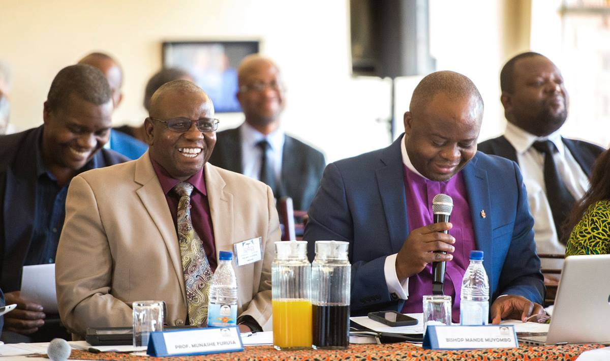 Bishop Mande Muyombo (front, right) presides over a meeting of the Africa University board of directors in Mutare, Zimbabwe. Mande is the first Africa University graduate to chair the board. Photo courtesy of Africa University.