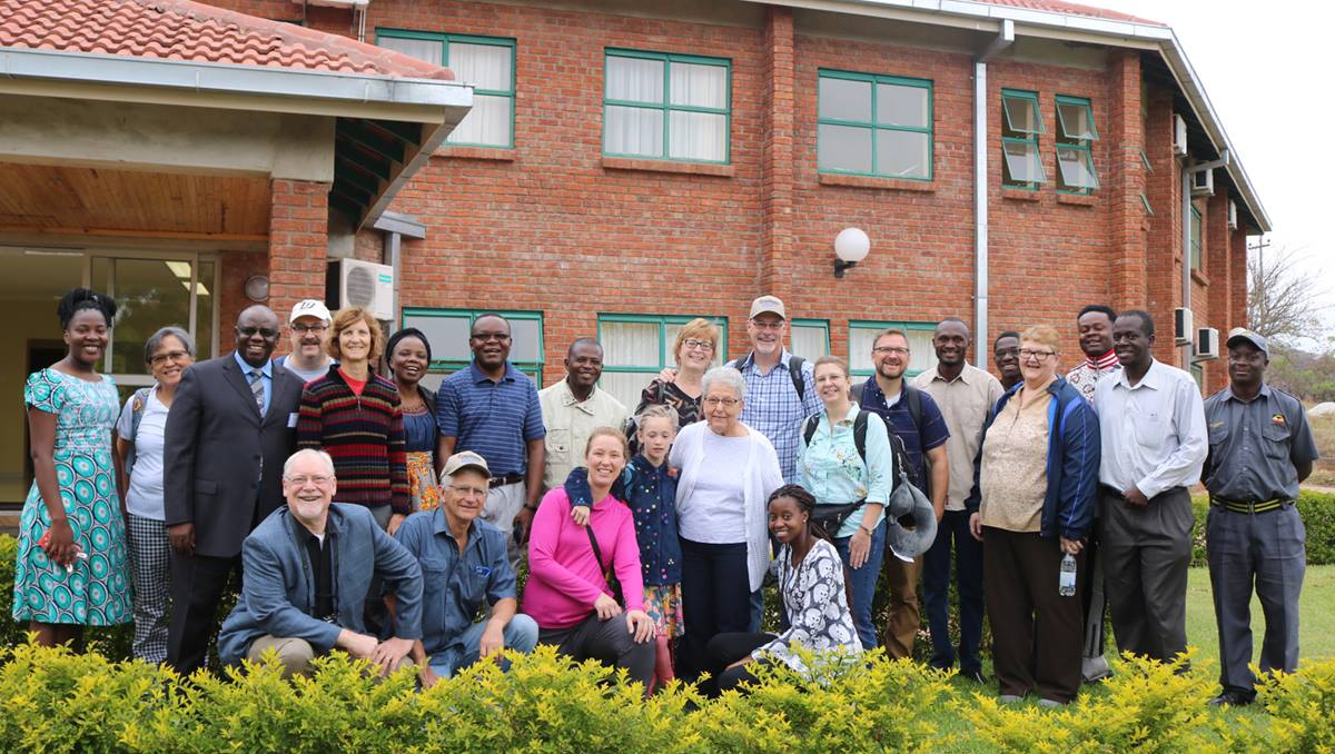 Members of a United Methodist delegation from Iowa and staff from Africa University pose in front of the Ubuntu Center, a retreat and meeting facility at the United Methodist-related institution in Mutare, Zimbabwe. Photo by Eveline Chikwanah.