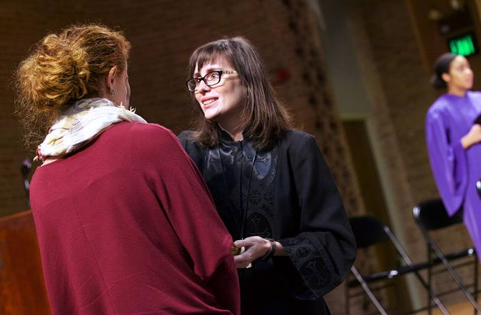 The Rev. Paige Swaim-Presley (center) imposes ashes on the forehead of a student at Millsaps College in Jackson, Miss., during Ash Wednesday services in 2018. A grant from the Lilly Endowment to the United Methodist-related college will help women clergy in the South with mentoring and networking. File photo courtesy of Millsaps College.