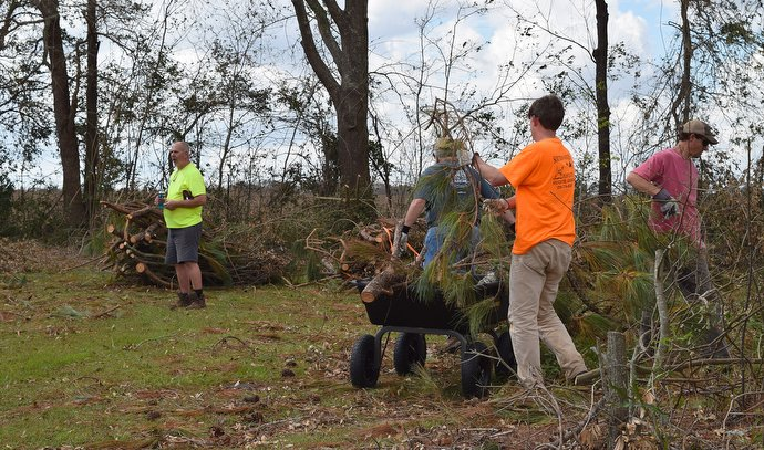 Members of an early response team from the South Georgia Conference of The United Methodist Church clean up storm debris left by Hurricane Michael in Donalsonville, Ga. Photo courtesy of the South Georgia Conference.