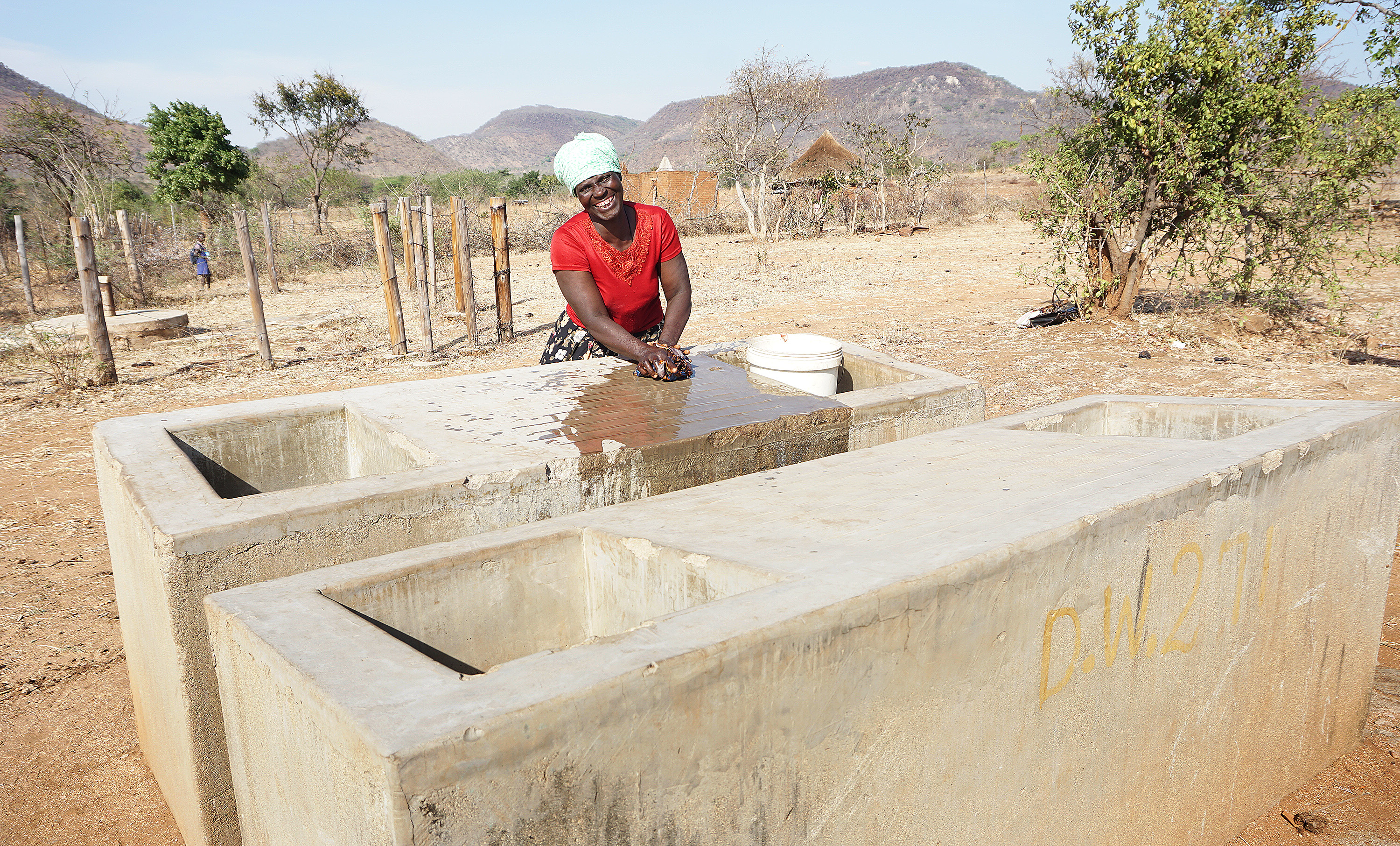 Maria Mandipaza tries out the new laundry basin donated by United Methodists from Norway. Photo by Kudzai Chingwe, UMNS.
